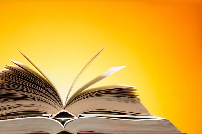 Open book against a yellow and orange background