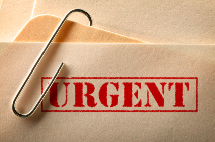"File folder with ""URGENT"" stamped on it in red"