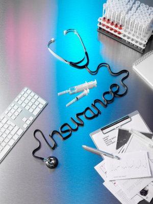 "Abstract insurance-related graphic, showing a stethoscope on a desk with its cord twisted into the cursive word ""insurance"""